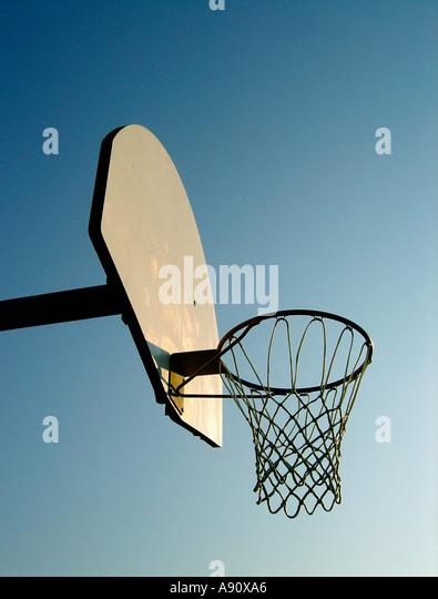 Urban Scene of a Basketball Hoop and Backboard in Late Afternoon Sun Copy Space - Stock Image
