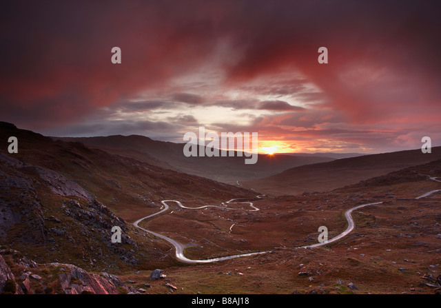 the road over the Healy Pass at dawn, Caha Mountains, Beara Peninsula, Co Cork, Ireland - Stock Image