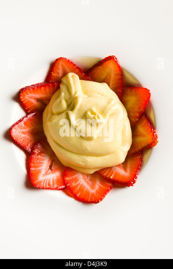 Sabayon with Strawberries prepared by Marcello Russodivito, Chef Owner of Marcello's Group. - Stock Image