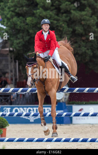 Furusiyya FEI Nations Cup Show jumping competition at Piazza di Siena. Neils Bruynseels riding Pommeau du Heup., - Stock Image