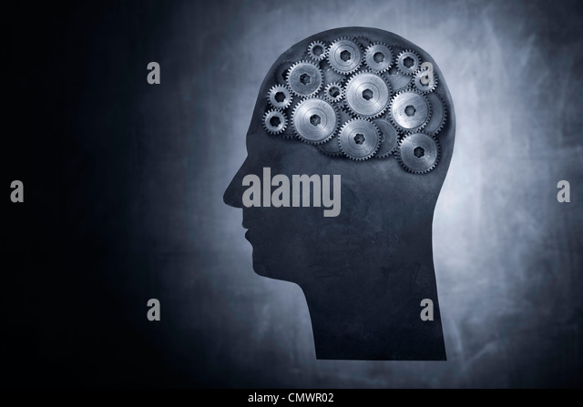 Conceptual image of head filled with cog gears. - Stock Image