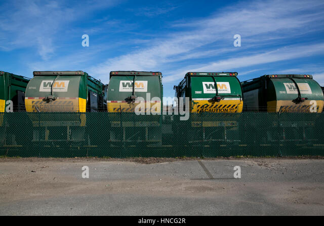 Logo signs on Waste Management, Inc., trucks in San Antonio, Texas on January 29, 2017. - Stock Image
