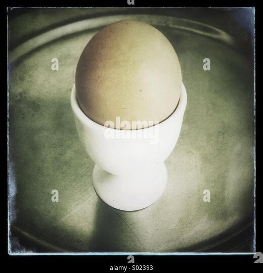 Boiled egg in egg cup - Stock Image