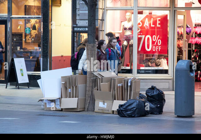 piles of cardboard for recycling collection outside shops in city centre Dublin Republic of Ireland - Stock Image