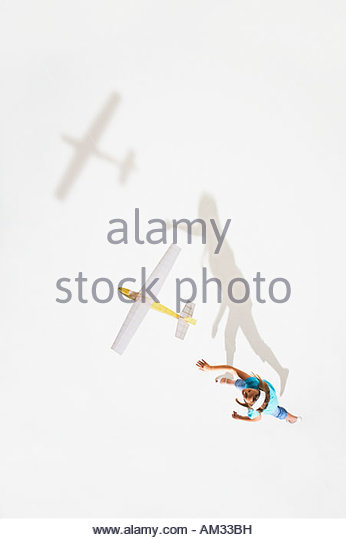 Girl playing with a toy plane - Stock Image