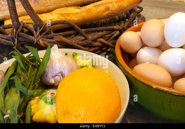 baskets of eggs, bread, squash, garlic and orange, Industrial Eats, Buellton, California - Stock Image