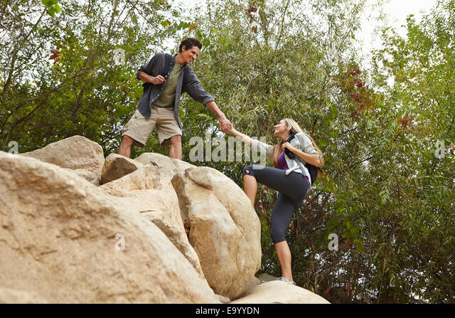 Couple rock climbing - Stock Image