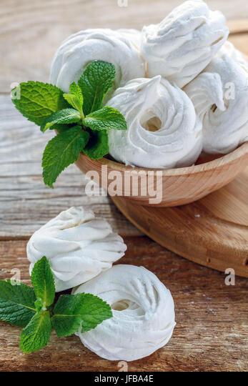 Tasty marshmallow and fresh mint. - Stock Image