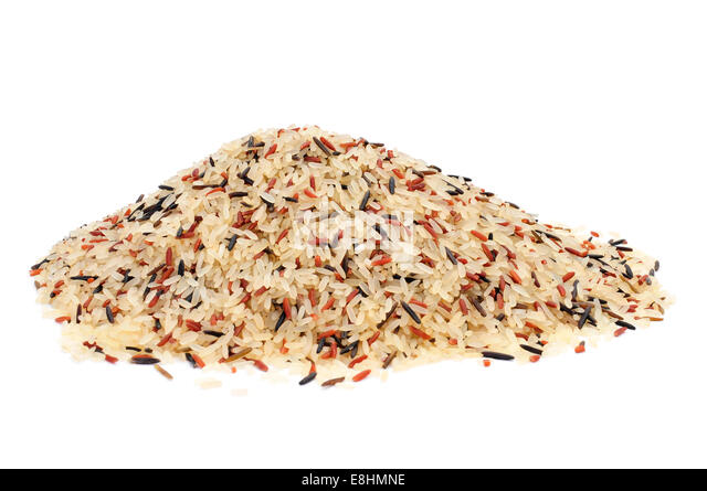 a pile of wild rice on a white background - Stock Image