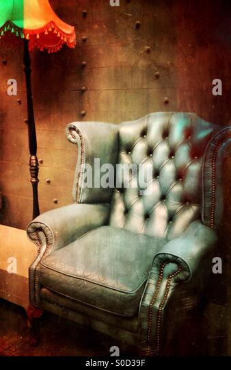 Vintage arm chair and lampshade - Stock Image