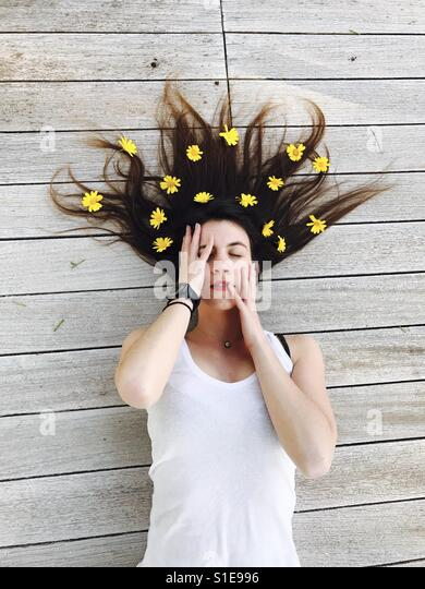 Woman with flower in her head - Stock Image