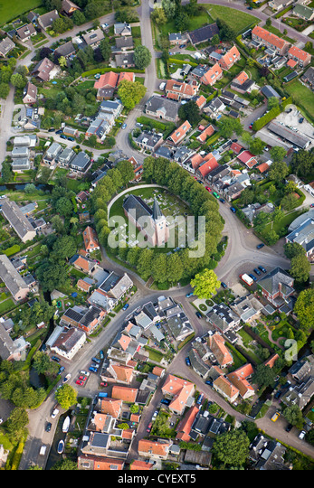 The Netherlands, Raerd, Aerial. Center of village with church on mount. - Stock Image