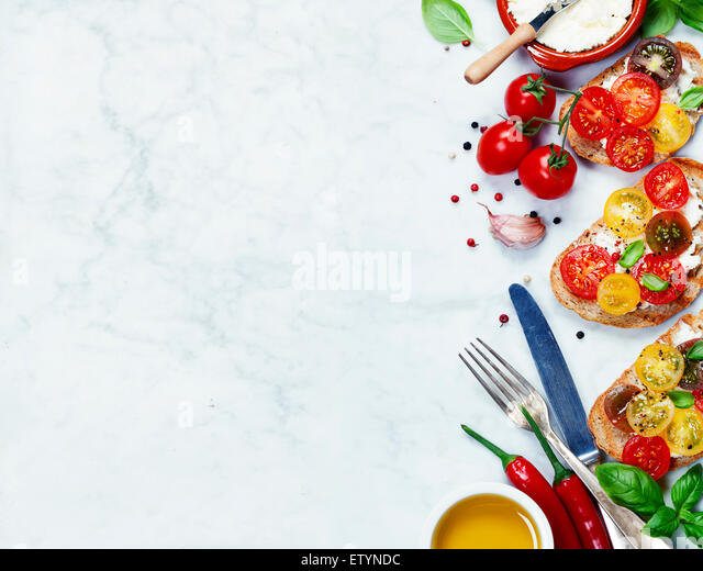 Tomato and basil sandwiches with ingredients - Italian, Vegetarian or Healthy food concept - Stock Image