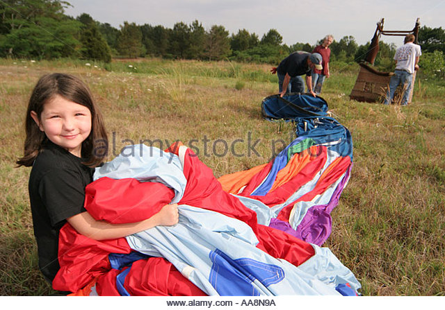 Alabama Decatur Alabama Jubilee Hot Air Balloon Classic gathering folding crew girl helps - Stock Image