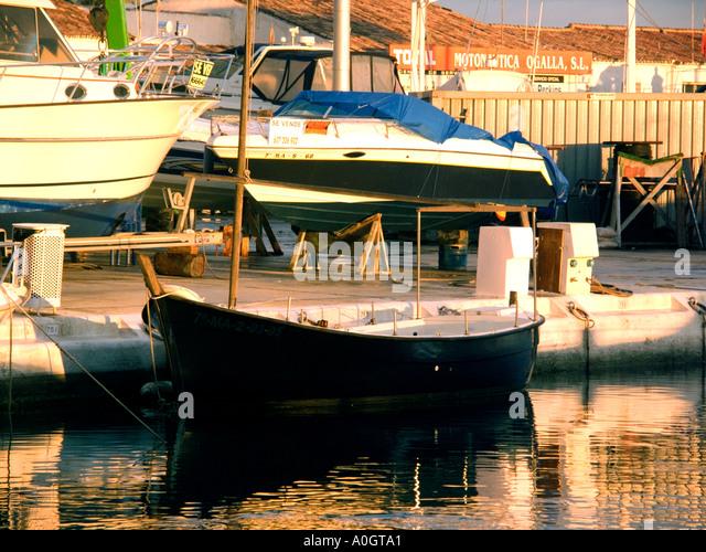 Puerto Banus boatyard at sunset, Costa del Sol, Spain - Stock Image