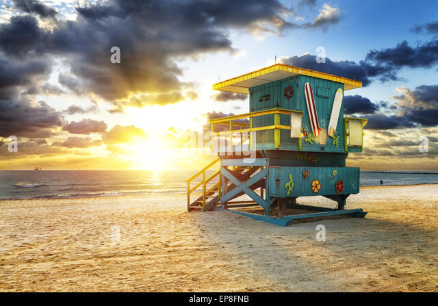 Miami South Beach sunrise with lifeguard tower and coastline with colorful cloud and blue sky. - Stock Image