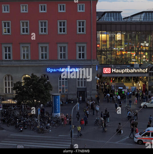 München Hauptbahnhof Munich and Sparda-Bank at dusk - Stock Image
