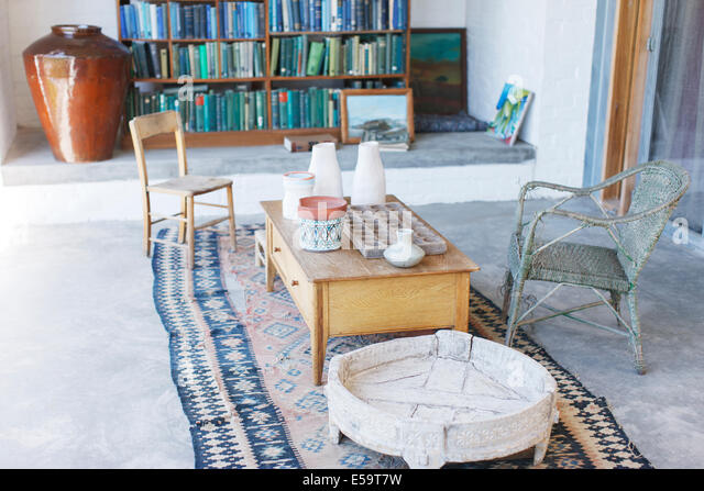 Coffee table and chairs in rustic study - Stock Image