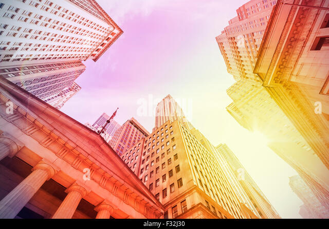 Vintage instagram filtered Wall Street at sunset, Manhattan, New York City, USA. - Stock Image