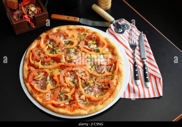 Gourmet pizza with peppers - Stock Image