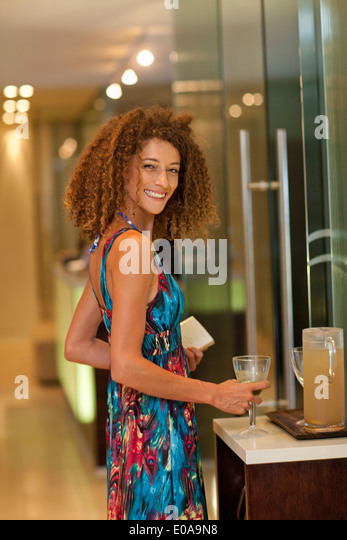 Portrait of relaxed young woman with drink in spa - Stock Image