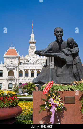 HCMC's People's Committee Building (Hotel de Ville) and Ho Chi Minh statue, Hoh Chi Minh City (Saigon), - Stock Image