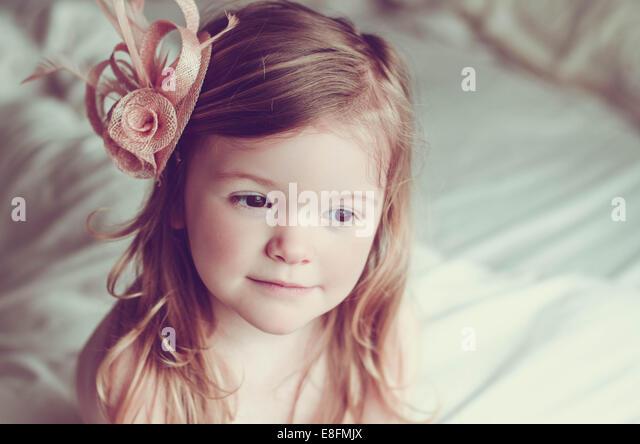 Portrait of Pretty Girl (2-3) wearing pink fascinator - Stock Image