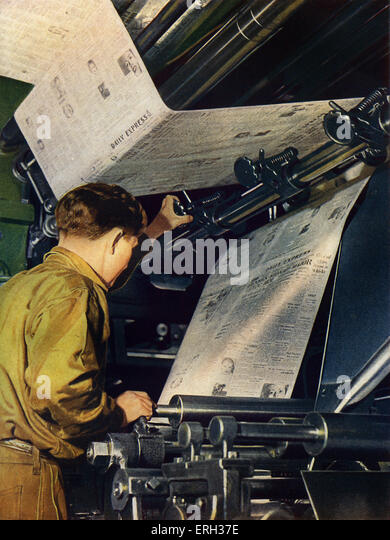 Newspaper Printing press, early 1950s. Operator inspecting newsprint, from The Wonder Book of How It's Done. - Stock Image