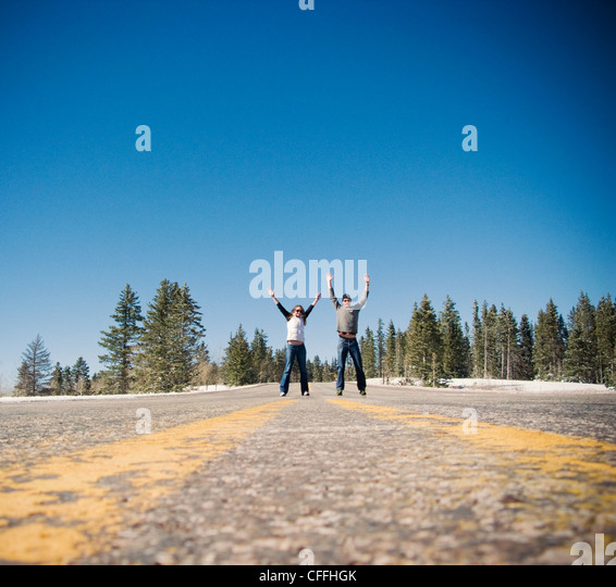 Two tourists on Route 64, Carson National Forest, New Mexico - Stock Image