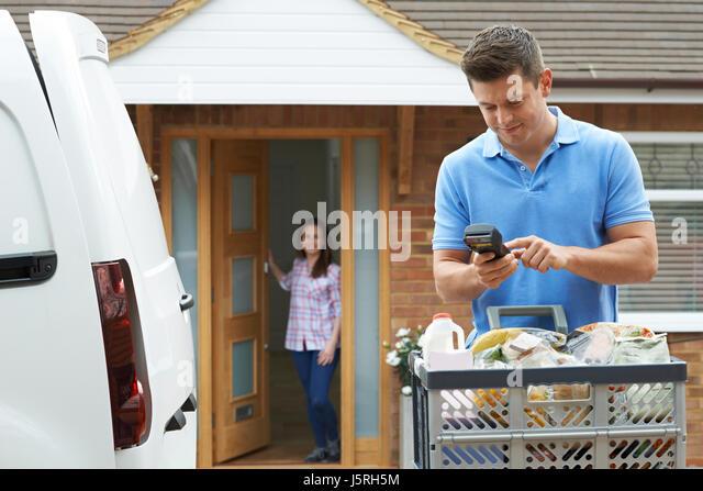 Man Delivering Online Grocery Order - Stock Image