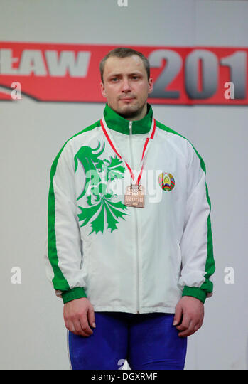Wroclaw, Poland. 27th Oct, 2013. Aleh Loban (BLR) won the bronze in snatch during Men's 105 KG Group A Final - Stock Image