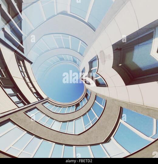 Digital Composite Image Of Modern Office Building Against Sky - Stock Image