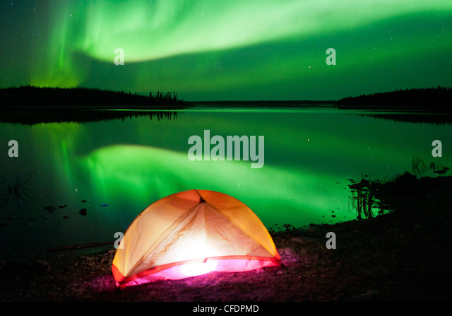 Tent and Aurora borealis (northern lights), boreal forest, Yellowknife environs, Northwest Territories, Canada - Stock Image