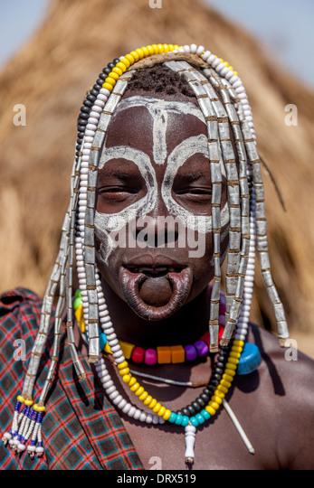 Portrait Of A Mursi Woman, Mursi Tribal Village, The Omo Valley, Ethiopia - Stock-Bilder