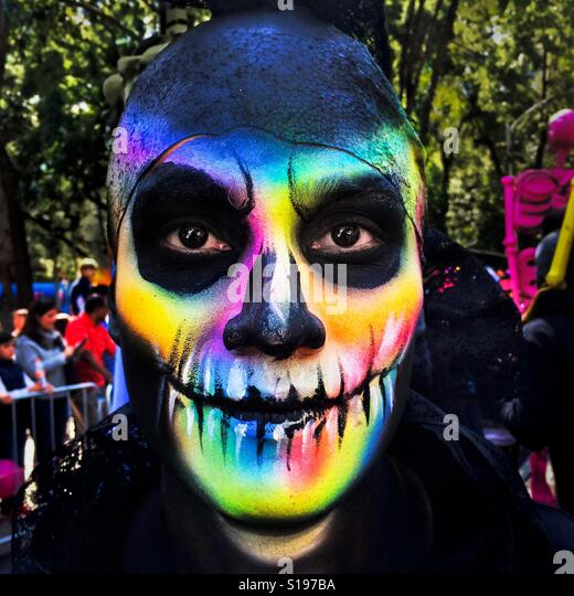 A young man, representing a Mexican cultural icon called La Catrina, takes a part in celebrations of the Day of - Stock Image
