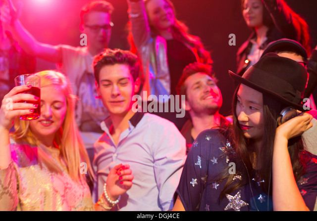 Mid adult woman DJ at party - Stock Image