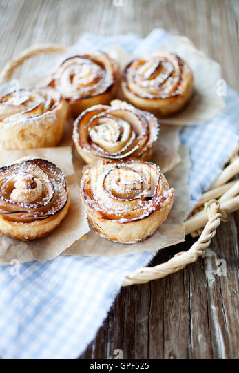 Delicious and beautiful apple rose puff pastries - Stock Image