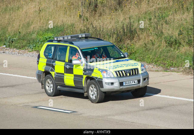 Highways Agency Traffic Office patrol car with reversed lettering on bonnet - Stock Image