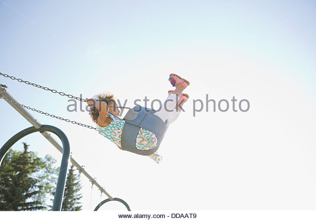 Little girl on swings - Stock Image