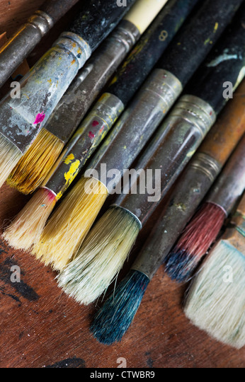 Well used Artists paint brushes - Stock Image