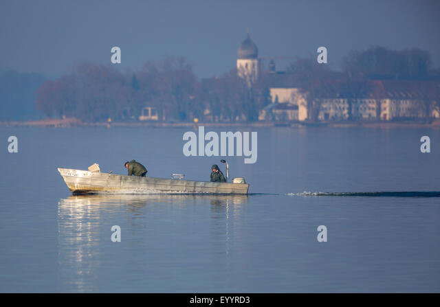fishermen at work, Germany, Bavaria, Lake Chiemsee - Stock Image