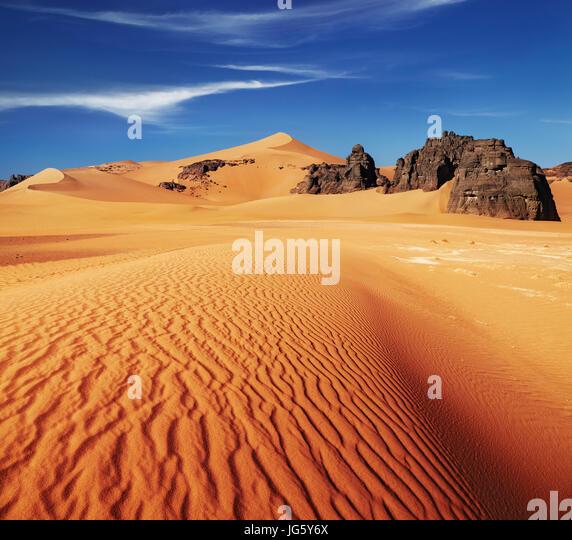 Sand dunes and rocks, Sahara Desert, Algeria - Stock Image