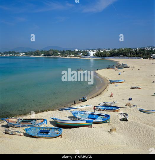 View along beach from the Medina walls, Hammamet, Cap Bon, Tunisia, North Africa, Africa - Stock Image