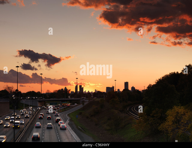Sunset scenery of commute traffic at the Gardiner Expressway in Toronto, Ontario, Canada. - Stock Image
