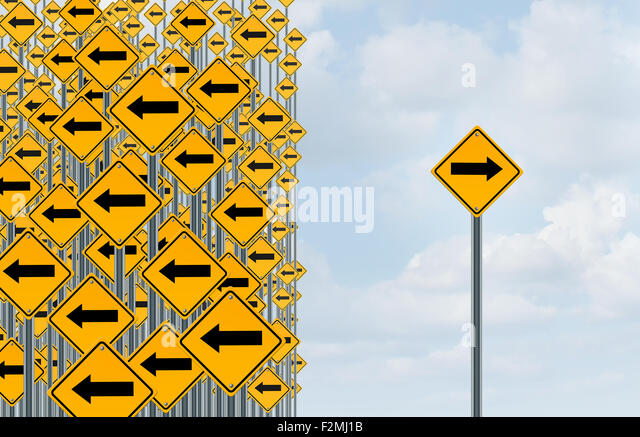 Direction individuality and independent thinking concept as a group of directional arrow traffic signs with one - Stock Image