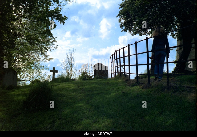 Tombstones near a Public Footpath England United Kingdom - Stock Image