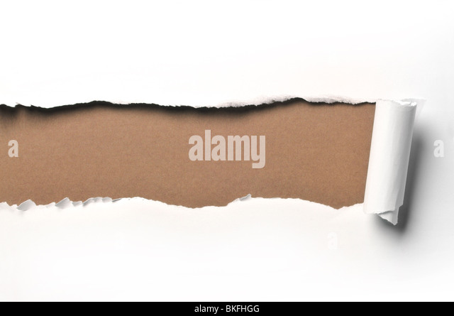 ripped white paper against a green background - Stock Image