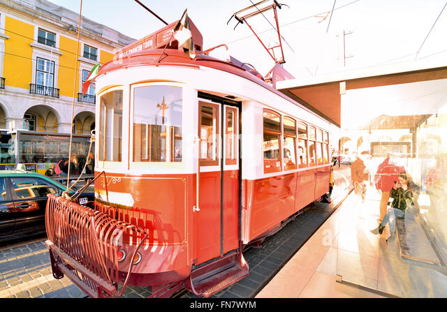 Portugal, Lisbon: Historic red tram stopping at Praca do Comercio - Stock Image