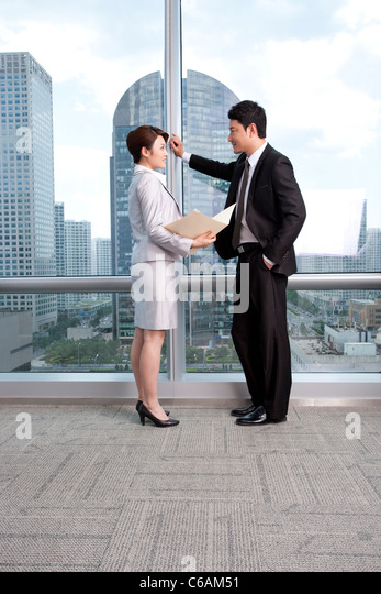 Chatting at the office - Stock Image