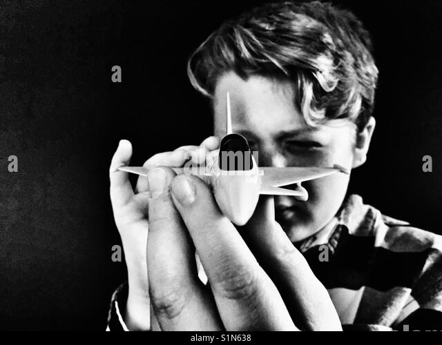 Boy Playing with model aircraft - Stock Image